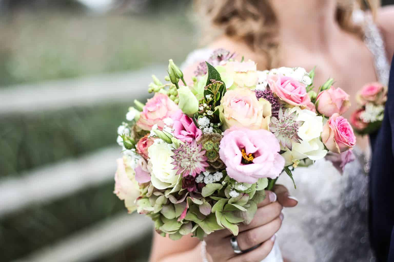 why do brides throw the bouquet
